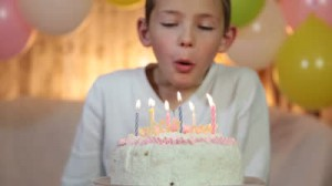 stock-footage-kid-blowing-out-candles-on-birthday-cake